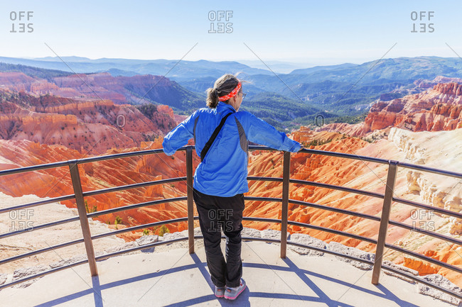 A female hiker enjoying the scenic view of Cedar Breaks National Monument