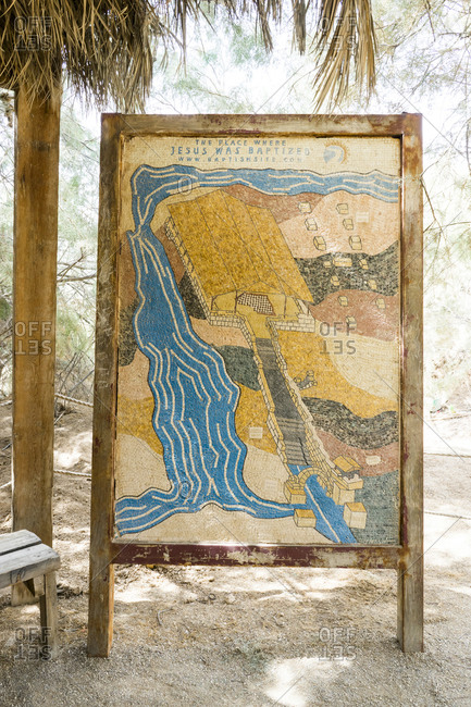 Jordan, Balqa Governorate, Al-Might's - October 1, 2016: Mosaic sign illustrating the place where Jesus Christ was baptized and the ruins of the church of John the Baptist, at the baptism site in Jordan on the east bank of the Jordan Riv