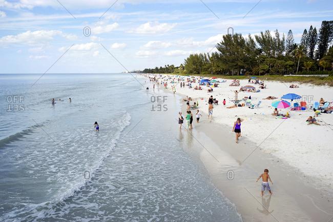 United States, Florida, Naples - February 7, 2015: People enjoying beach, Naples, Florida, USA