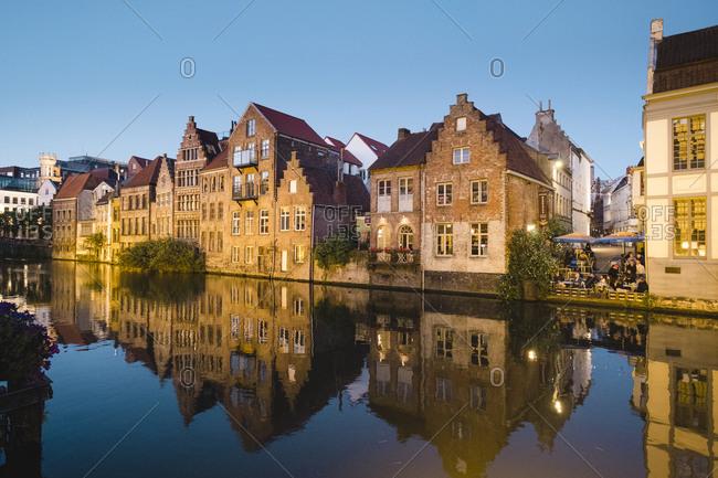 Belgium, Gent, Gent - June 18, 2018: Townhouses along river, Ghent, Flemish Region, Belgium