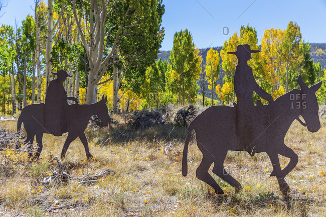 USA, Utah, Utah - September 11, 2018: Metal silhouettes to cowboys on horseback.