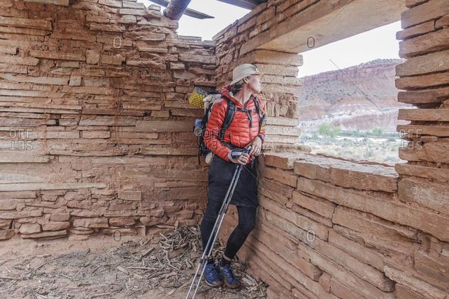Female hiker exploring Praia ghost town, Utah, USA