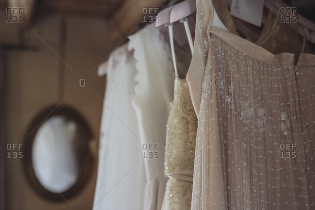 Wedding dresses hanging on coat hanger