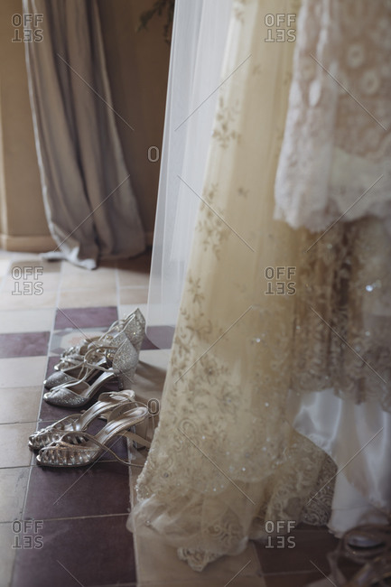 Wedding dresses and shoes on the floor