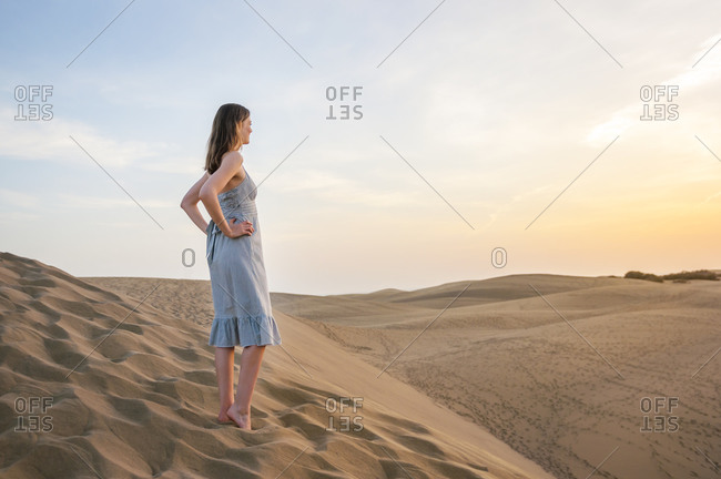 Woman at sunset in the dunes- Gran Canaria- Spain