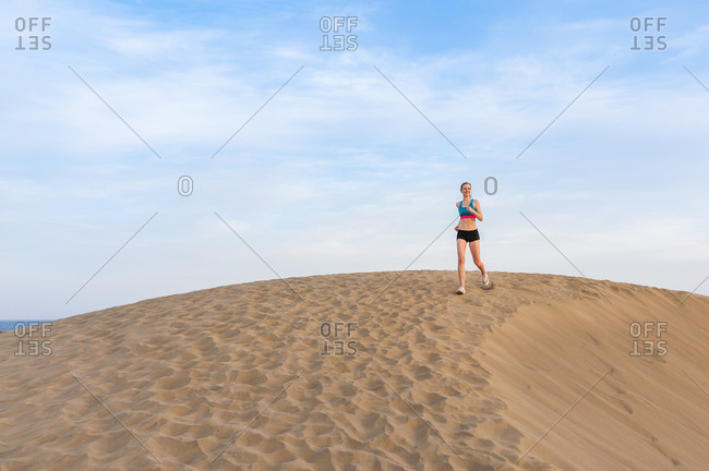 Woman running in the dunes- Gran Canaria- Spain