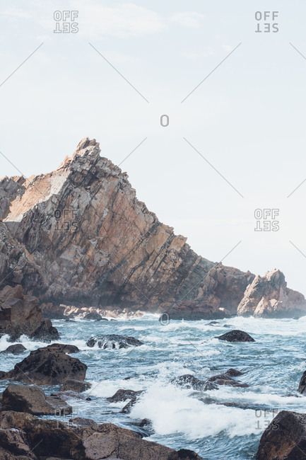 Scenic view of sea and mountain against sky- Ursa beach- Portugal