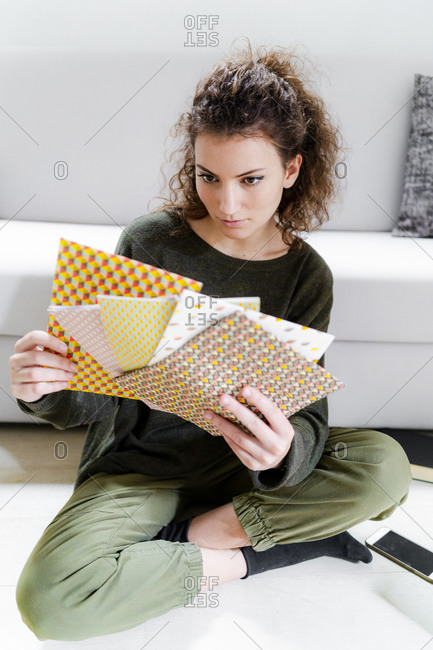 Portrait of young woman choosing wrapping paper