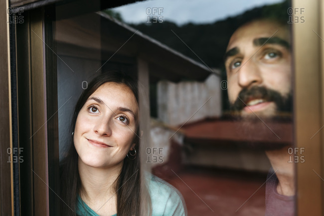 Couple looking out the window and thinking about the future