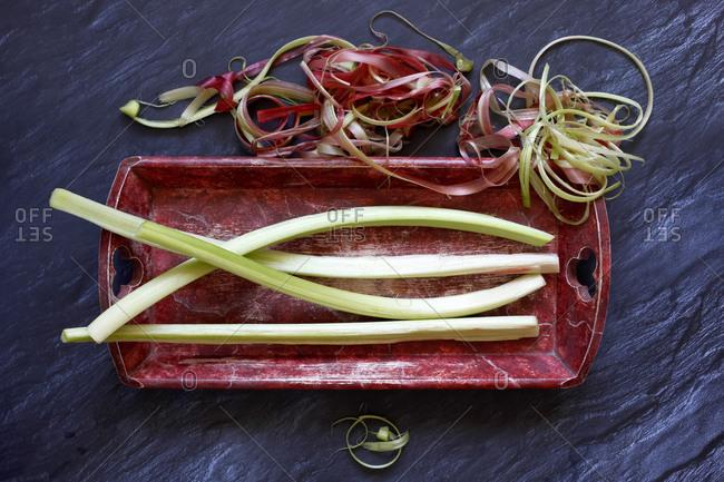 Tray of freshly peeled rhubarb stalks