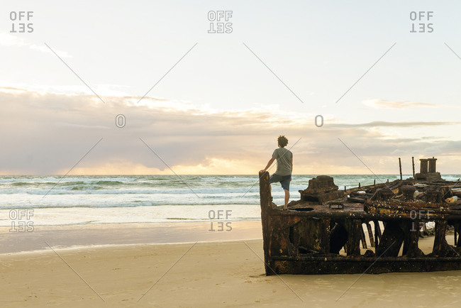 Man looking at sea while standing on Maheno shipwreck at Fraser Island- Queensland- Australia