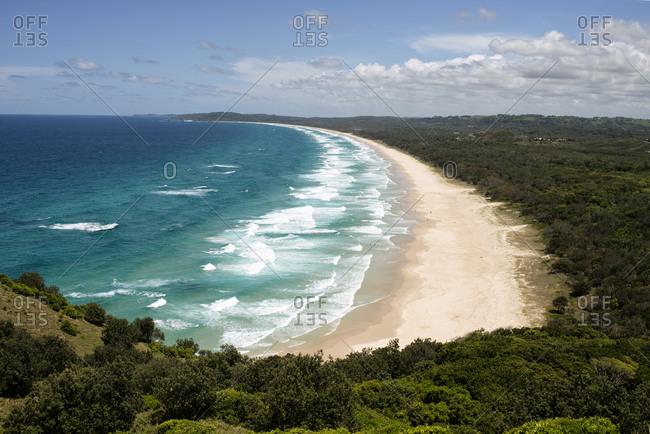 Aerial view of Tallow Beach against sky at Byron Bay- Queensland- Australia