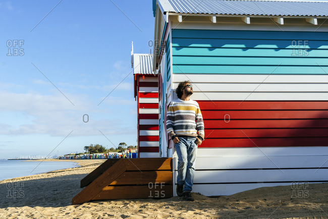 Man standing by cottage at Brighton Beach- Melbourne- Australia