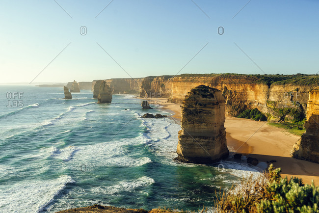 Scenic view of Twelve Apostles against clear sky during sunset- Great Ocean Road- Victoria- Australia