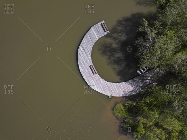 Russia- Moscow Oblast- Aerial view of curved jetty on shore of Lake Dolgoe