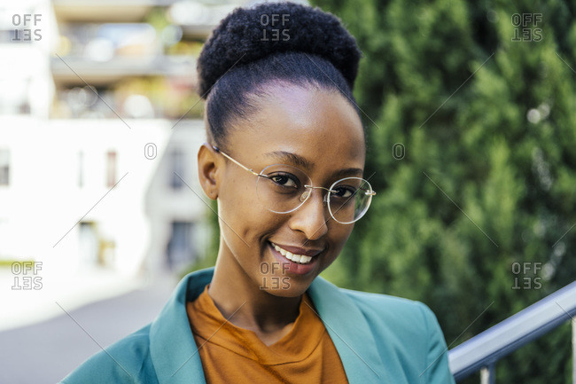 Portrait of smiling young businesswoman wearing glasses