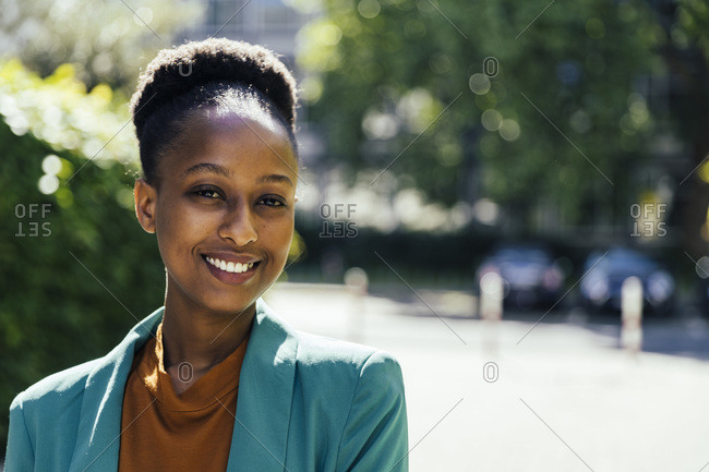 Portrait of smiling young businesswoman outdoors