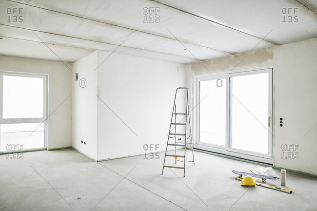 Room with ladder on construction site