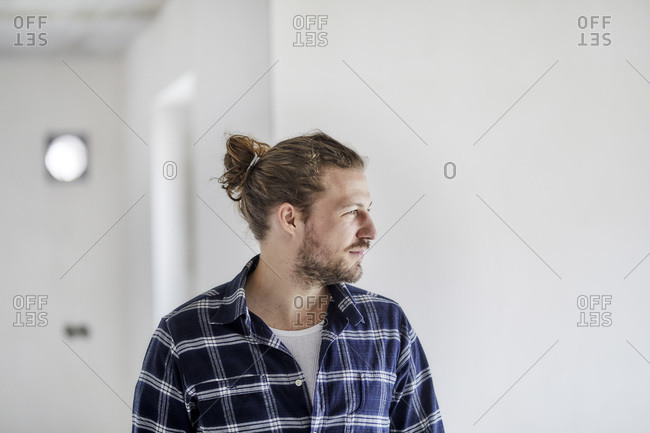 Portrait of a young man wearing checked shirt