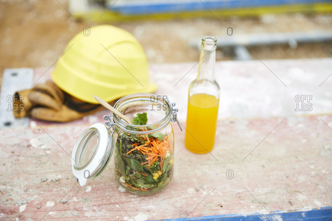 Salad to go- lemonade and hard hat on construction site