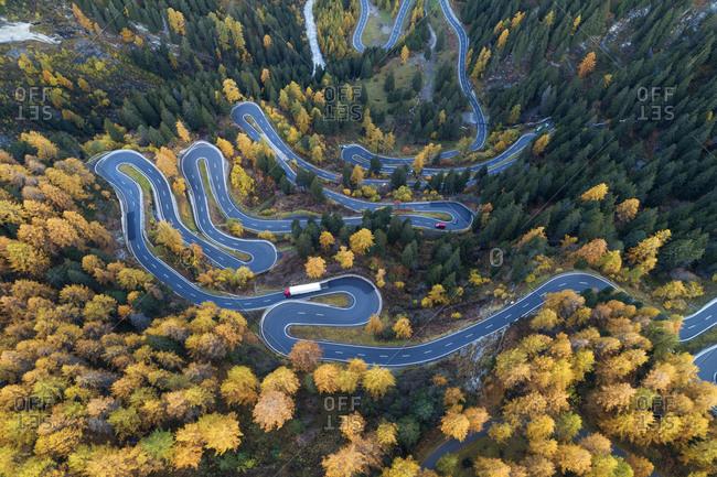 Switzerland- Canton of Grisons- Saint Moritz- Drone view of Maloja Pass in autumn