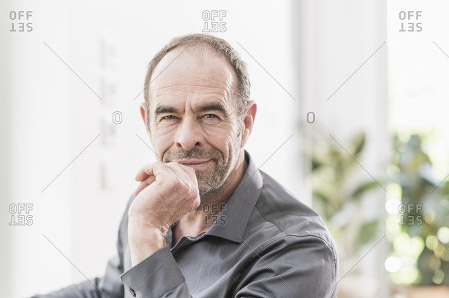 Portrait of mature businessman with stubble