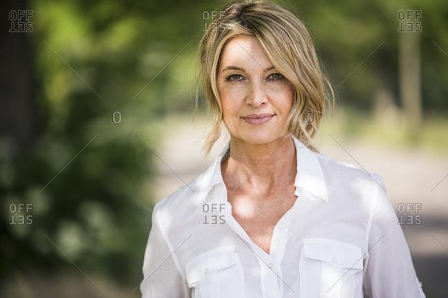 Confident mature businesswoman standing outdoors
