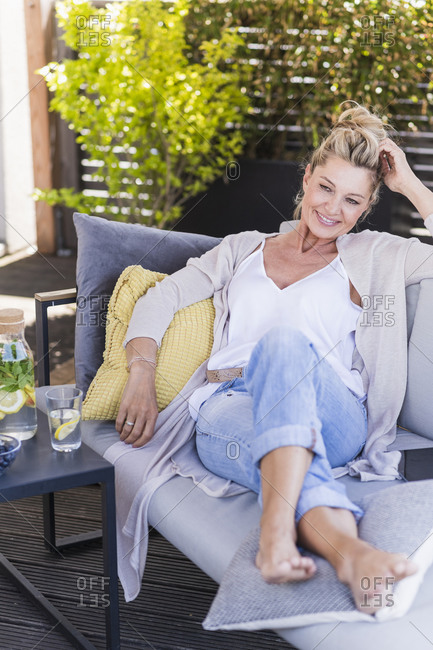 Portrait of smiling mature woman relaxing on terrace