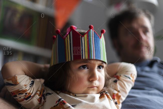 Portrait of angry little girl celebrating birthday