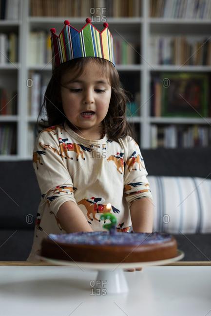 Portrait of little girl celebrating birthday at home