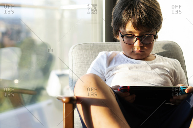 Boy playing video game on a games console