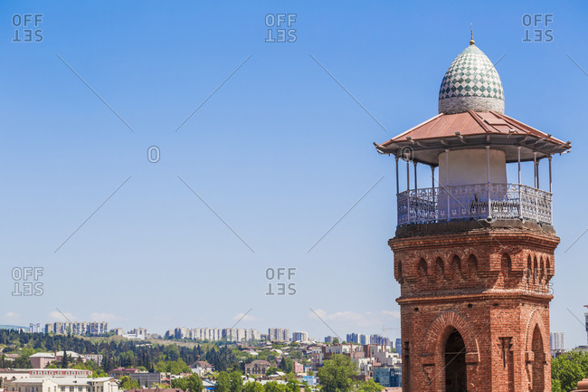 Minaret of Jumah Mosque against clear blue sky during sunny day- Tbilisi- Georgia