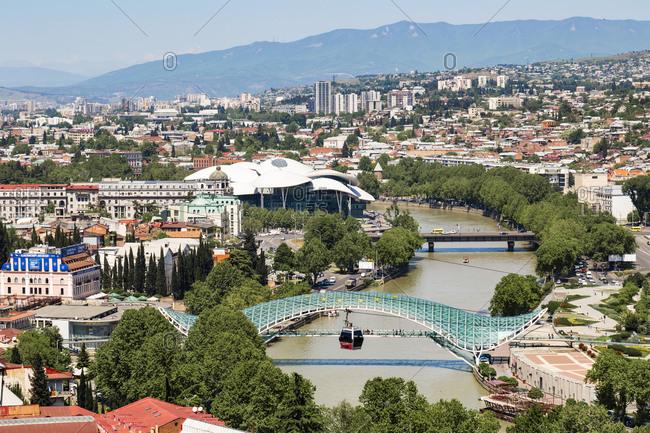 May 2, 2018: Bridge of Peace over Kura River against cityscape- Tbilisi- Georgia