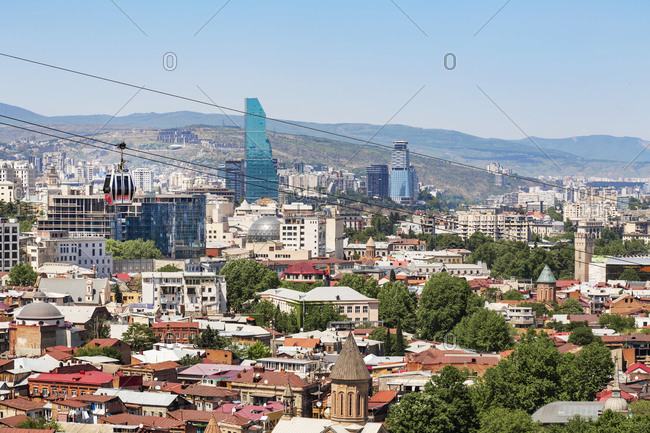Cityscape against mountains against clear sky during sunny day- Tbilisi- Georgia