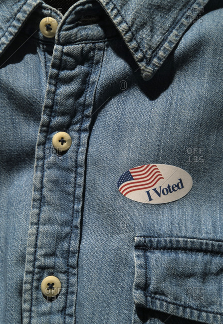 Close-up of I voted sticker on denim shirt