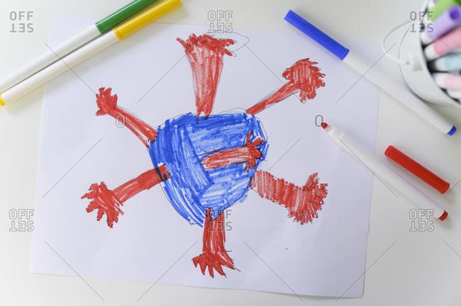 Marker drawing of coronavirus on paper