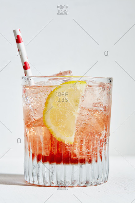 Aperol spritz with lemon and straw