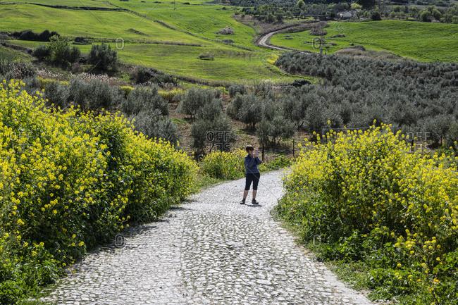 Spain, Ronda, Woman hiking in springtime
