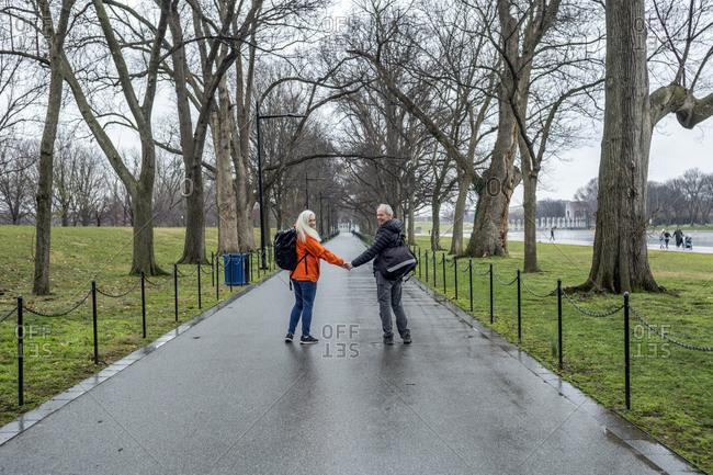 USA, Washington D.C., Senior couple posing for photo in park