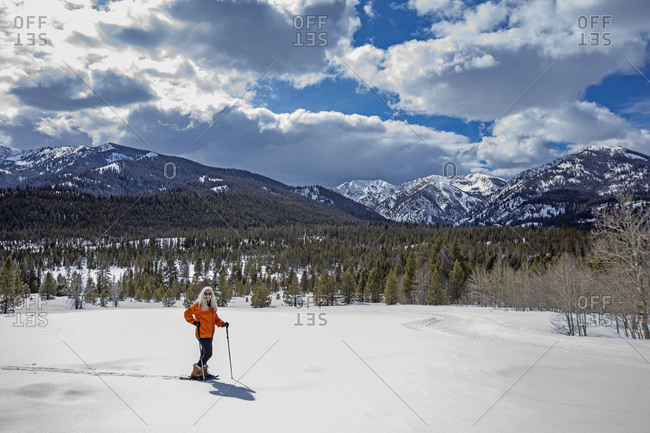 USA, Idaho, Sun Valley, Woman snowshoeing in winter landscape