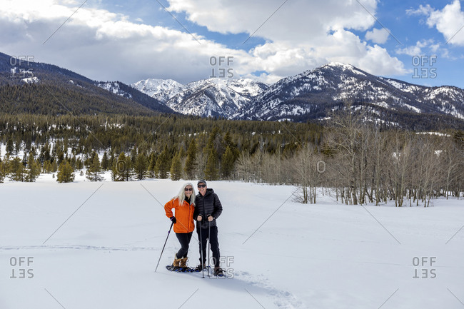 USA, Idaho, Sun Valley, Portrait of man and woman snowshoeing in winter landscape