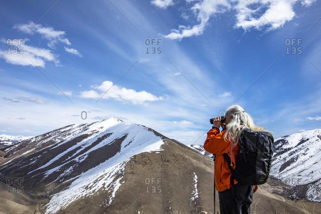 USA, Idaho, Bellevue, Senior woman looking at view through binoculars