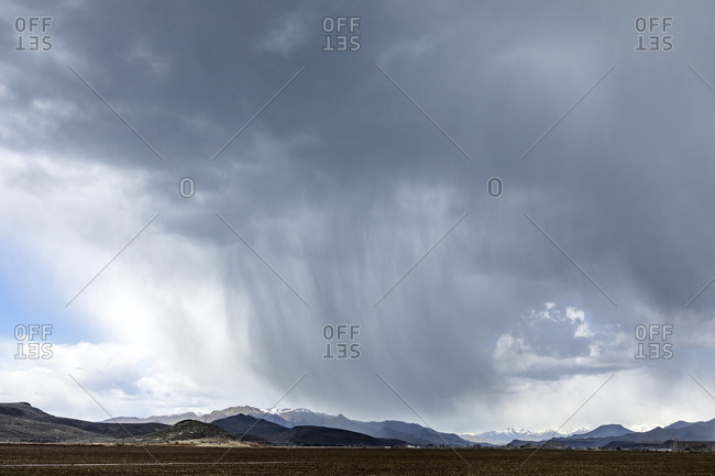 USA, Idaho, Picabo, Storm clouds over fields