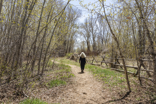 USA, Idaho, Bellevue, Senior woman walking along rural path