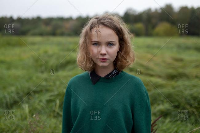 Russia, Omsk, Portrait of teenage girl in meadow