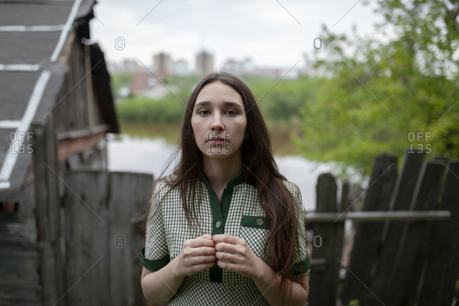 Russia, Omsk, Portrait of young woman in backyard
