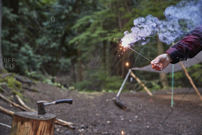 Orcas Island, Man holding sparkler at camping