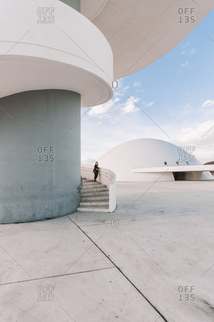 October 17, 2014: Anonymous visitor standing on spiral stairway of concrete Tower building in Oscar Niemeyer International Cultural Centre in Spain