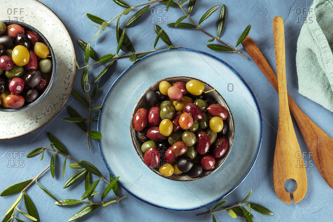 Olives. A variety of green, black and red olives, with leaves, shot from the top