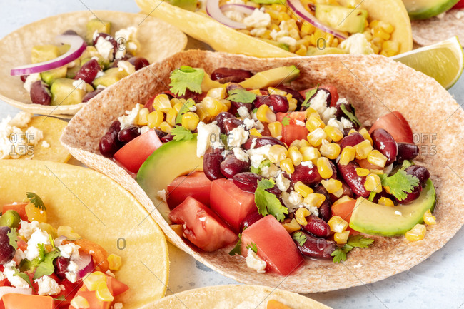 Mexican food. Vegetarian tacos with tomato, avocado and corn